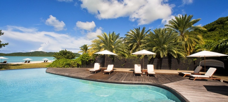 Idyllic  swimming pool located in between tropical gardens at Hermitage Bay, Antigua