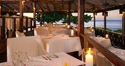 Ocean-side formal dining area at Hermitage Bay, Antigua