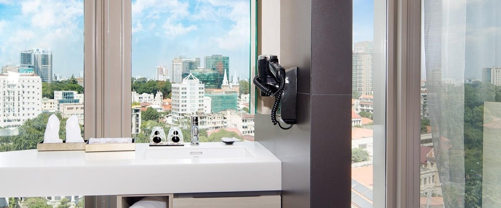 Bathroom With A View at Liberty Central Saigon Citypoint Hotel, Vietnam