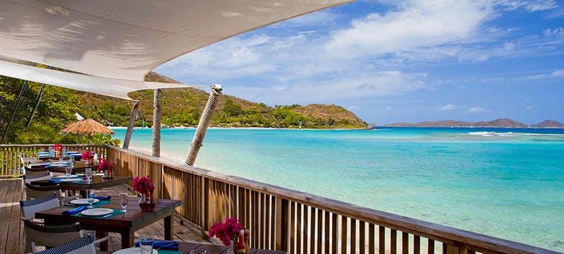 Enjoy casual dining overlooking the ocean at Rosewood Little Dix Bay, British Virgin Islands