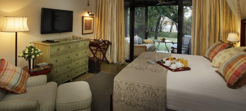 Bedroom at The Royal Livingstone by Anantara