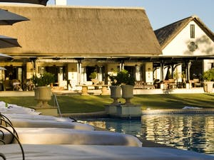 Pool area at The Royal Livingstone by Anantara