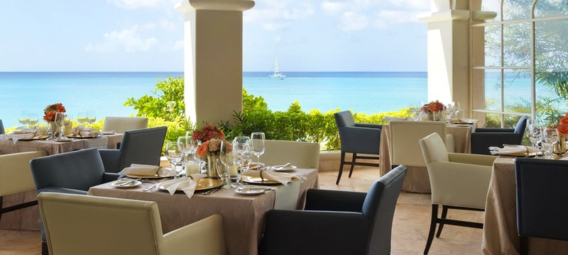 Palm terrace serving locally inspired and innovative dishes at The Fairmont Royal Pavilion, Barbados
