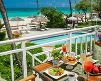 Caribbean Village Honeymoon Beachfront Butler Suite at Sandals Grande Antigua