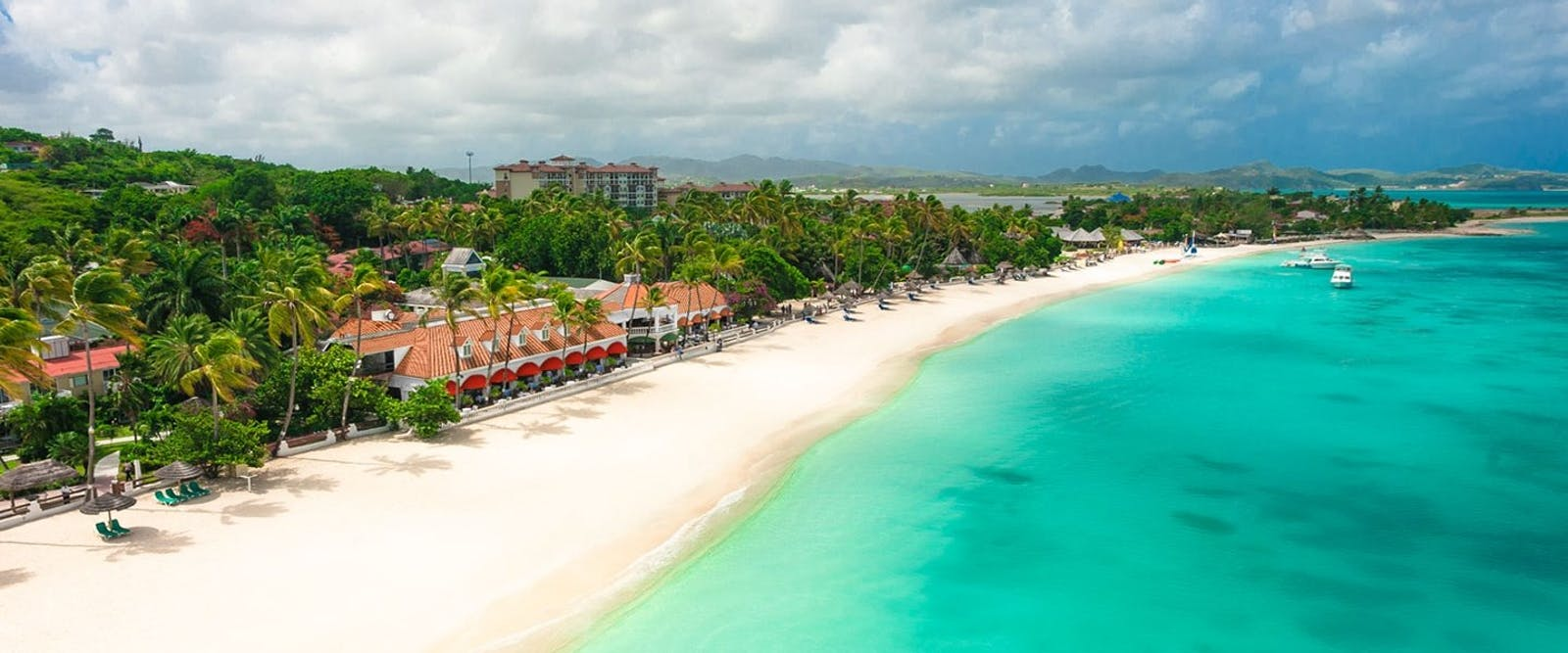 0ed3245cf7fe 1 12 - Caribbean Village Beach at Sandals Grande Antigua