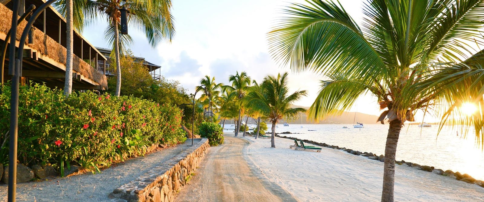 Take a stroll down the sandy path along the shore at Bitter End Yacht Club, British Virgin Islands
