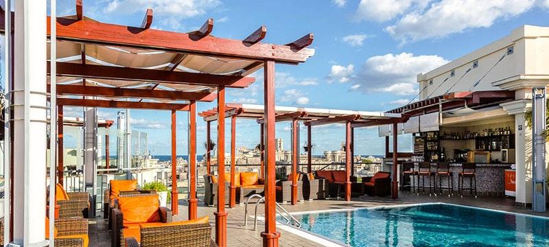 The pool area at Hotel Saratoga, Cuba
