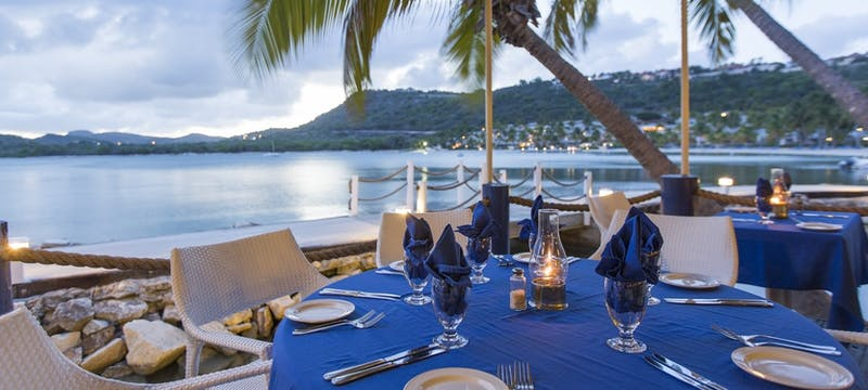Indulge in Caribbean-inspired dishes with a stunning view of Mamora Bay at St James's Club & Villas, Antigua