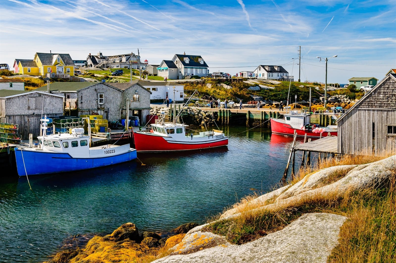 fishing boats anchored and waiting in a secluded bay in peggys cove