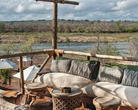 Sitting area with a beautiful view at Azura Selous Game Reserve