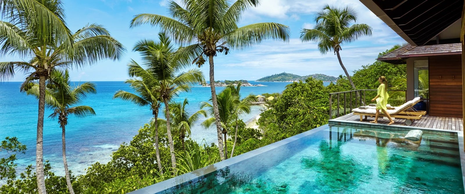 Infinity pool and loungers at six senses zil pasyon seychelles
