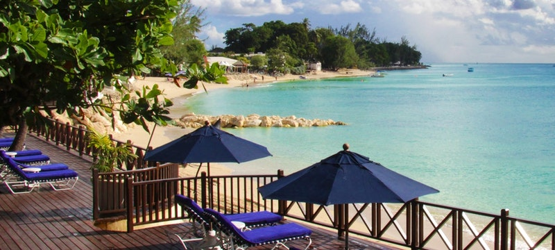 Relax on the terrace overlooking the ocean at The Sand Piper, Barbados