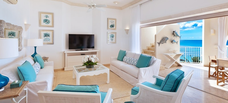 Luxurious living room area overlooking the ocean in the deluxe beachfront penthouse at Saint Peters Bay, Barbados