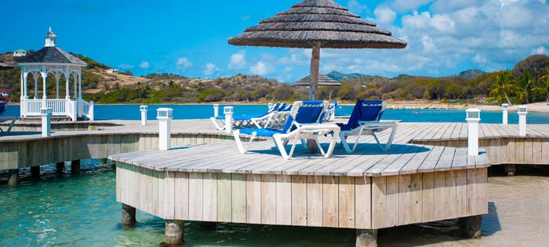 Sun loungers on the boardwalk at St James's Club & Villas, Antigua