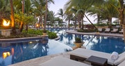 Pool area in the evening at The St Regis Bahia Beach Resort, Puerto Rico