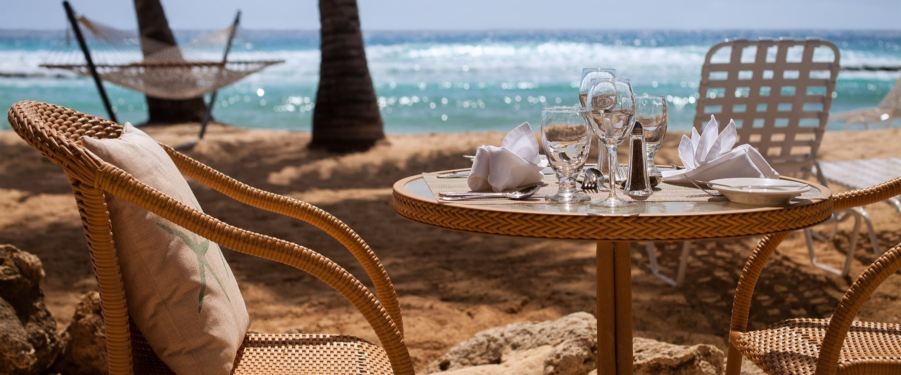 dine next to the ocean at reef restaurant at sugar bay barbados