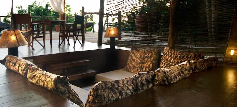Lounge area in suite at Fundu Lagoon