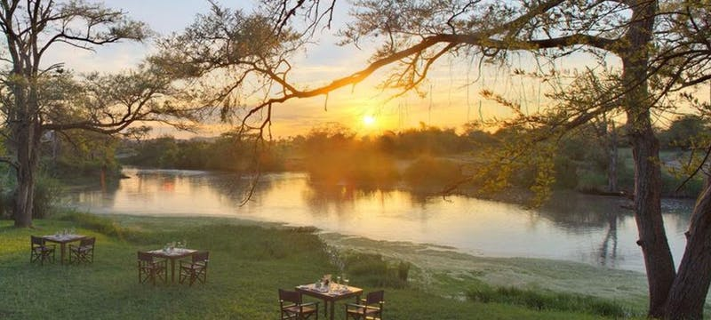 Dine with a sunset view at &Beyond Grumeti Serengeti Tented Camp