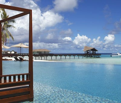 Swimming pool overlooking the ocean at The Residence Maldives