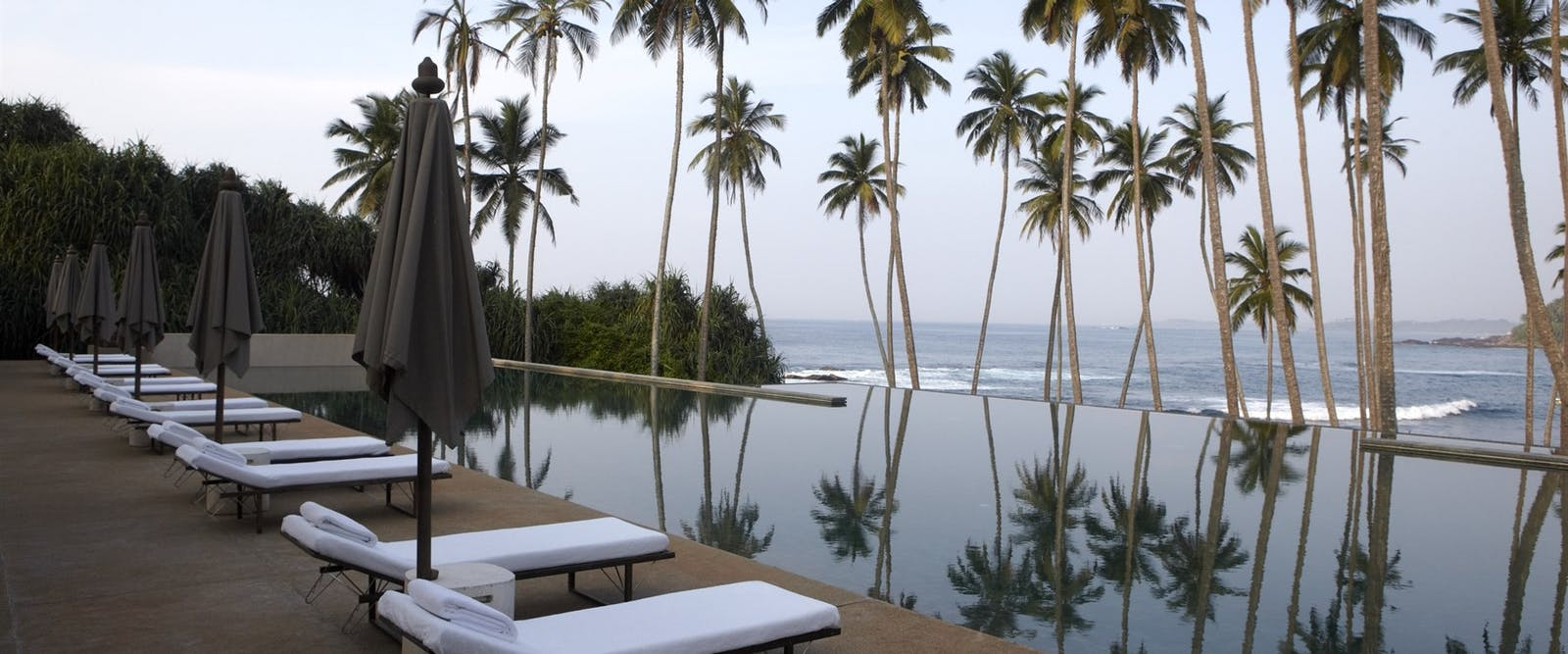 Swimming Pool with palm trees at Amanwella, Sri Lanka