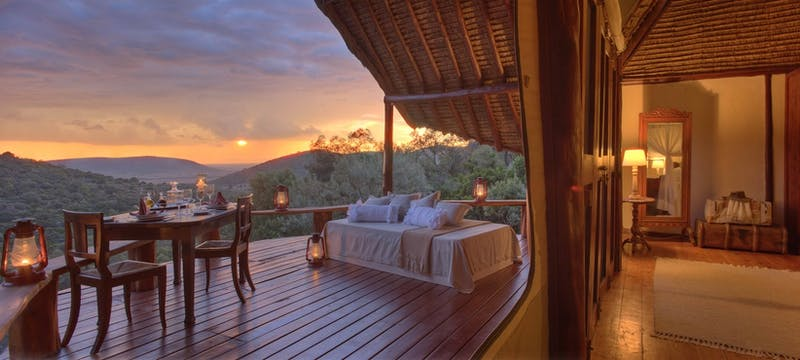 Lock shack honeymoon suite with private deck at  at Saruni Mara Lodge