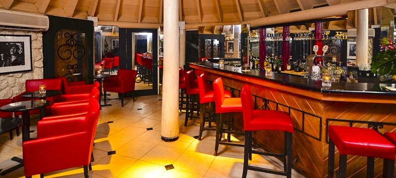 Enjoy an evening in the piano bar at The Club Barbados Resort & Spa, Barbados