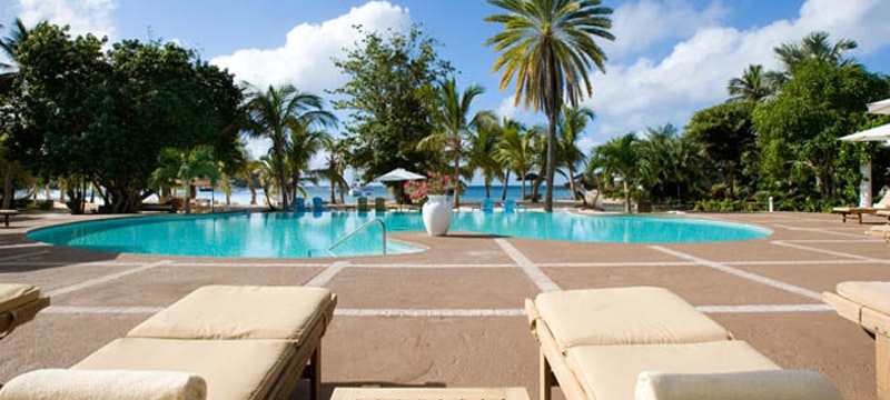 Relax by the pool at The Inn at English Harbour, Antigua
