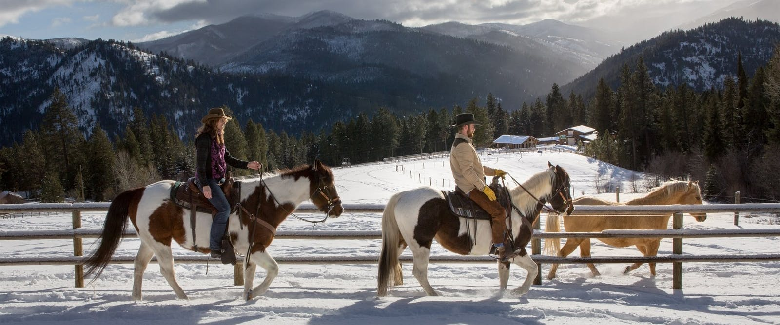 Horse riding In Snow At Triple Creek Ranch