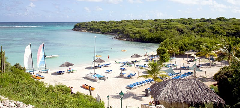 Take a relaxing walk along the beach at The Verandah Resort & Spa, Antigua