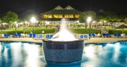Stunning view of the main pool area lit up in the evening at The Verandah Resort & Spa, Antigua