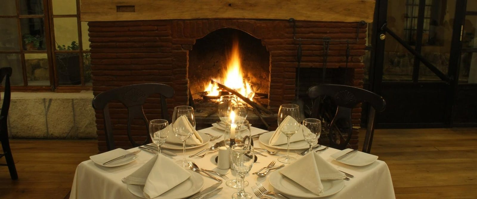 Restaurant table in front of fireplace, Sonesta Posada del Inca Yucay