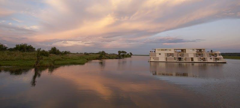 Zambezi Queen cruising along the river