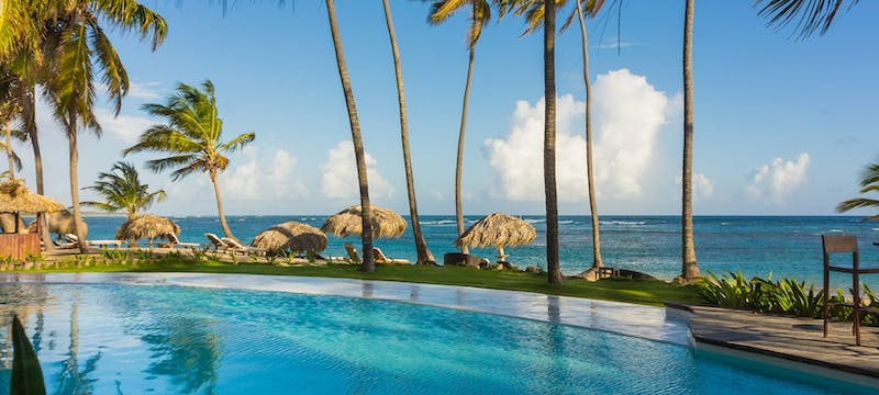 Pool area overlooking the ocean at Zoetry Agua Punta Cana, Dominican Republic