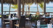 Relaxed beachfront restaurant with light international cuisine at Zoetry Agua Punta Cana, Dominican Republic